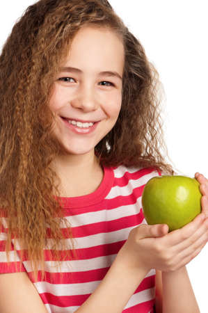 Portrait of happy girl with apple isolated on white background photo