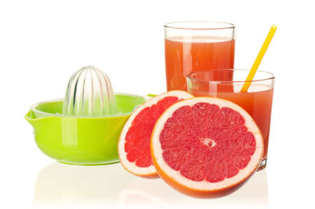 Glass of fresh grapefruit juice, juicer and grapefruit fruits on white background photo