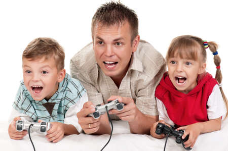 Happy family - father and children playing a video game Stock Photo - 13103711