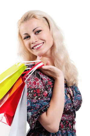 Portrait of a young woman holding a shopping bags over white background Stock Photo - 13103672