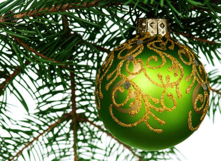 Small bauble on green christmas firtree on white background Stock Photo - 13145992