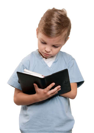 Portrait of a little boy holding a books over white background photo