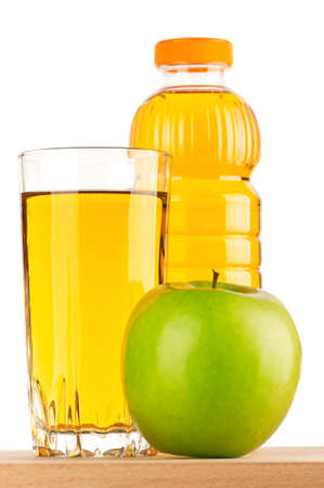 Apple juice in plastic bottle and glass on wooden board over white background