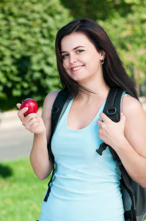 Portrait of a young female student with bag at the campus photo