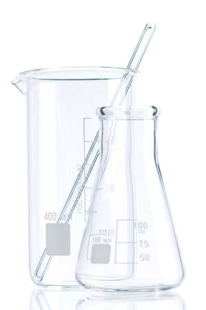 Laboratory glassware for liquids on white background photo