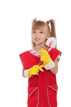 Portrait of beautiful little housewife with toilet brush isolated on white background  photo