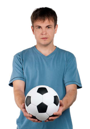 Portrait of a man standing with classic soccer ball on isolated white background Stock Photo - 13145488