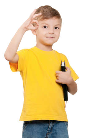 Portrait of little schoolboy holding book on white background Stock Photo - 13144979
