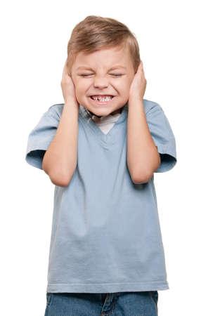 Hear no evil - Portrait of funny little boy over white background photo