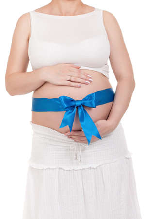 Pregnant belly with blue ribbon - isolated over a white background  Third trimester  photo