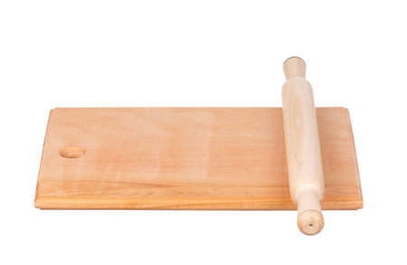 Wooden hardboard with rolling pin isolated on white background photo
