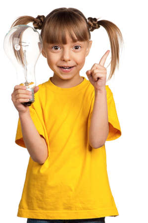 Portrait of happy little girl with light bulb isolated on white background photo