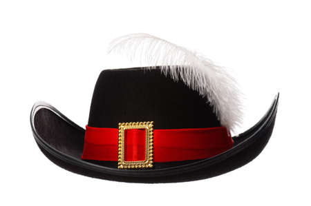 Black hat with feather and ribbon isolated on white background photo