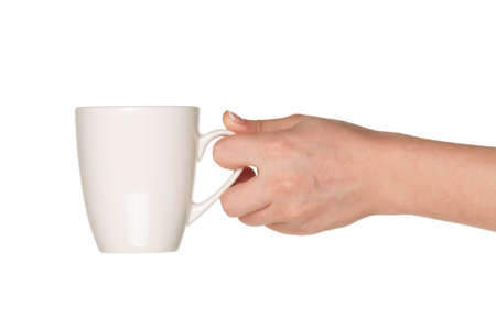 mug shot: Woman hand with perfect white cup isolated on white background Stock Photo