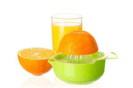 Glass of fresh orange juice, juicer and orange fruits on white background