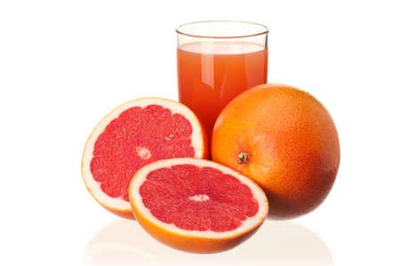 Glass of fresh grapefruit juice and grapefruit fruits on white background photo