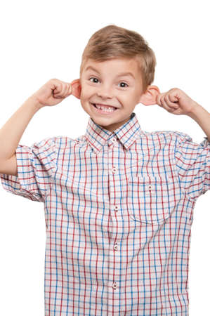 Portrait of funny little boy on white background photo