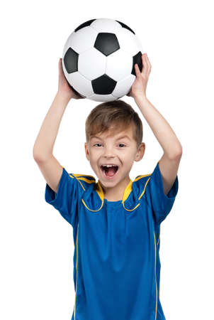 Little boy in ukrainian national soccer uniform with classic soccer ball on isolated white background Stock Photo
