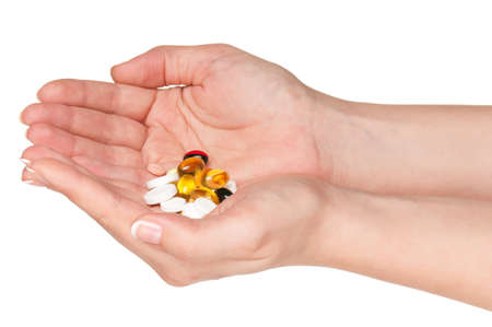 Pills in woman hands isolated on white background photo
