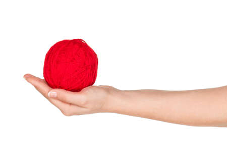 Woman hand with red ball of yarn for knitting isolated on white background photo