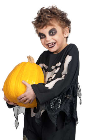Portrait of little boy wearing halloween costume with pumpkin on white background photo