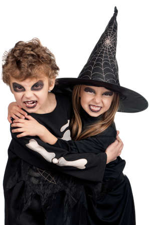 Boy and girl wearing halloween costume on white background photo