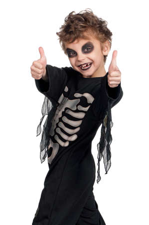 Portrait of little boy wearing halloween costume on white background photo