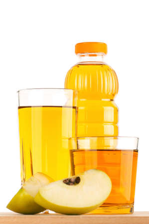 Apple juice in plastic bottle and glass on wooden board over white background photo