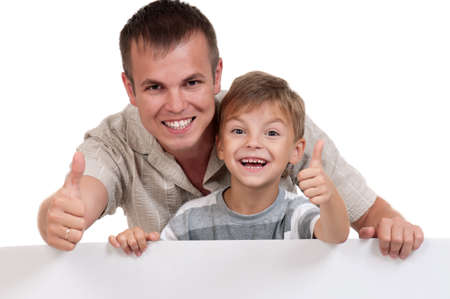Portrait of happy dad and son with empty white board isolated on white background Stock Photo - 14735957