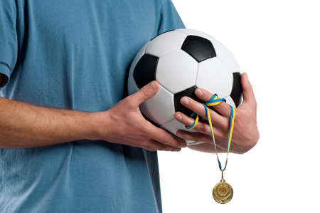 Man with classic soccer ball and medal on isolated white background Stock Photo - 14736052