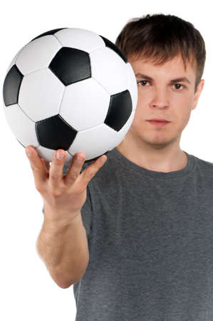 Portrait of a man standing with classic soccer ball on isolated white background Stock Photo - 14735986