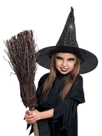 witch face: Portrait of little girl in black hat and black clothing with broom on white background Stock Photo