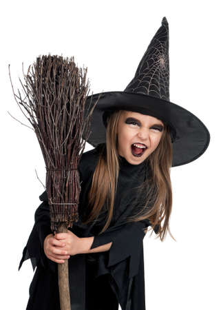 Portrait of little girl in black hat and black clothing with broom on white background Stock Photo - 14765834