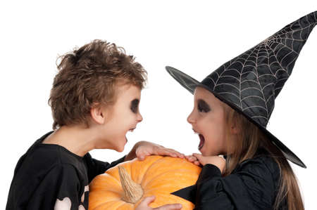 halloween skeleton: Boy and girl wearing halloween costume with pumpkin on white background