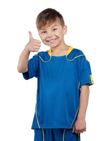 Little boy in ukrainian national soccer uniform on isolated white background photo