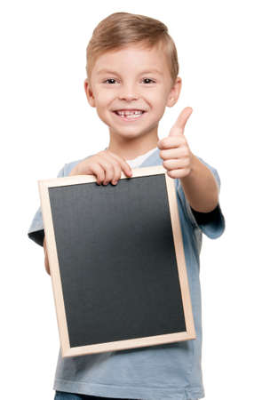 Portrait of a little boy holding a blackboard over white background photo