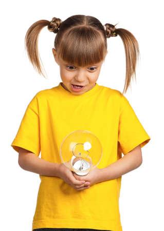 Portrait of surprised little girl with light bulb isolated on white background photo