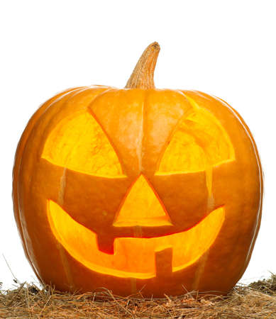 Funny Halloween pumpkin glowing on white background photo