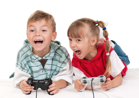 Happy children - girl and boy playing a video game photo