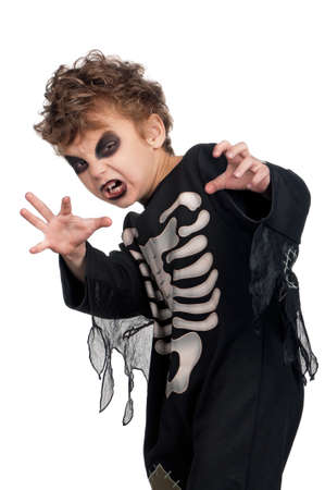 skeleton hand: Portrait of little boy wearing halloween costume on white background