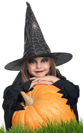halloween witch: Portrait of little girl in black hat and black clothing with pumpkin on white background