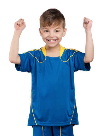 Little boy in ukrainian national soccer uniform on isolated white background photo