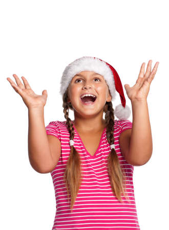 Portrait of happy girl in Santa hat over white background photo