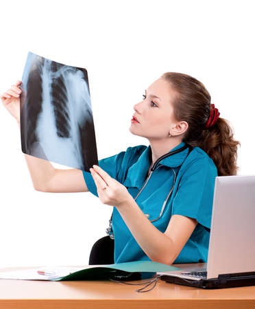 Medical doctor analysing x-ray photography on white background photo