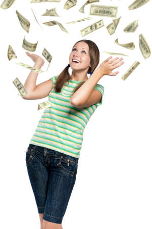 Beautiful teen girl catching falling dollars banknotes on white background photo