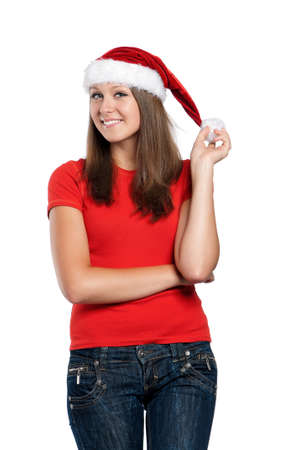 Beautiful teen girl in Santa hat posing on white background photo