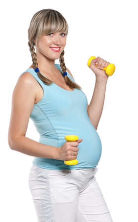 Pregnant woman in a fitness workout using hand weights isolated on white background photo