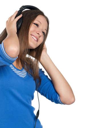 Beautiful teen girl with headphones posing on white background Stock Photo - 15287332
