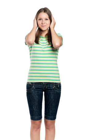 Hear no evil - portrait of teen girl isolated on white background photo