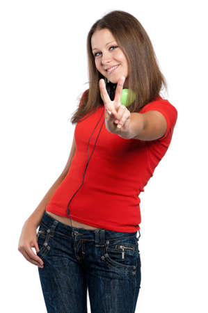Beautiful teen girl with headphones posing on white background photo